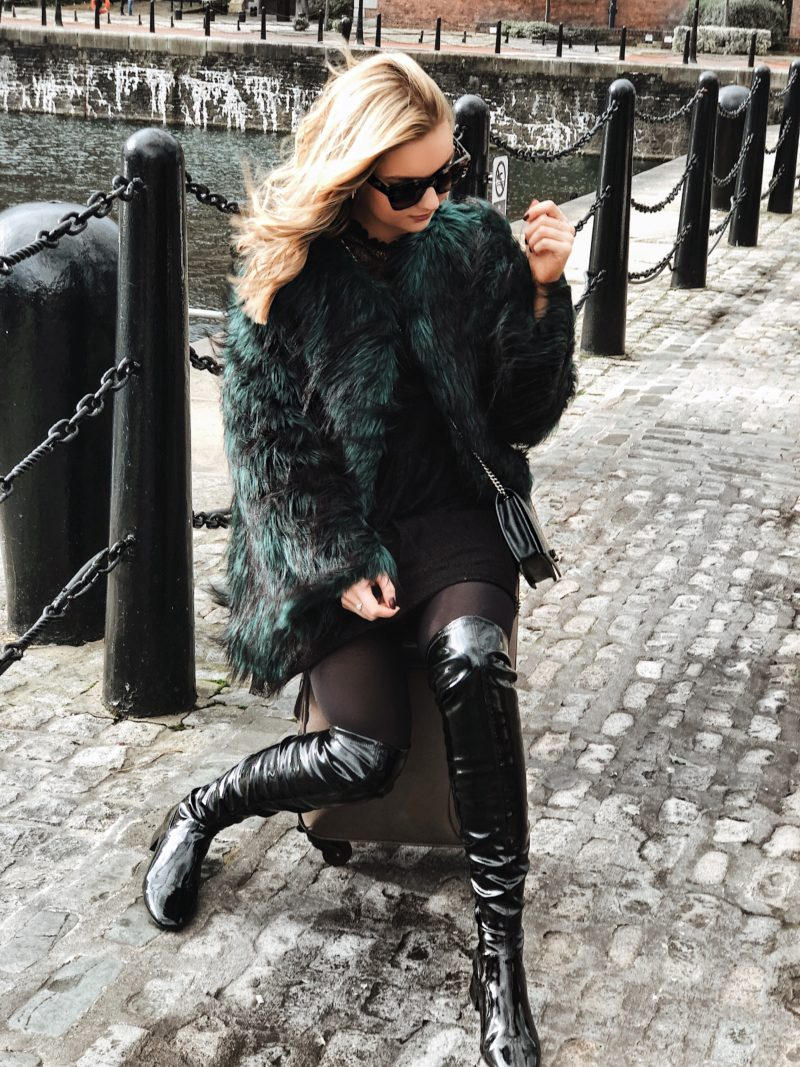 green fluffy coat